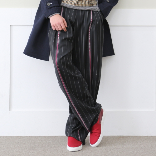 Black selvedge two tuck wide trousers